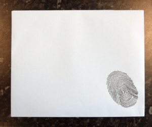 Printed graphic on paper - fingerprint is composed of words/phrases
